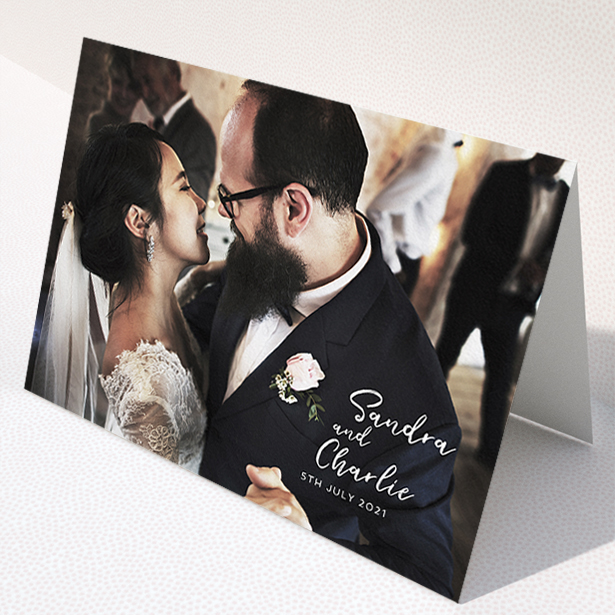 """A photo wedding thank you card design called """"1 Photo Full"""". It is an A5 card in a landscape orientation. It is a photographic photo wedding thank you card with room for 1 photo. """"1 Photo Full"""" is available as a folded card, with mainly white colouring."""