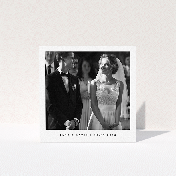 """A photo wedding thank you card called """"Big centre"""". It is a square (148mm x 148mm) card in a square orientation. It is a photographic photo wedding thank you card with room for 1 photo. """"Big centre"""" is available as a folded card, with mainly white colouring."""