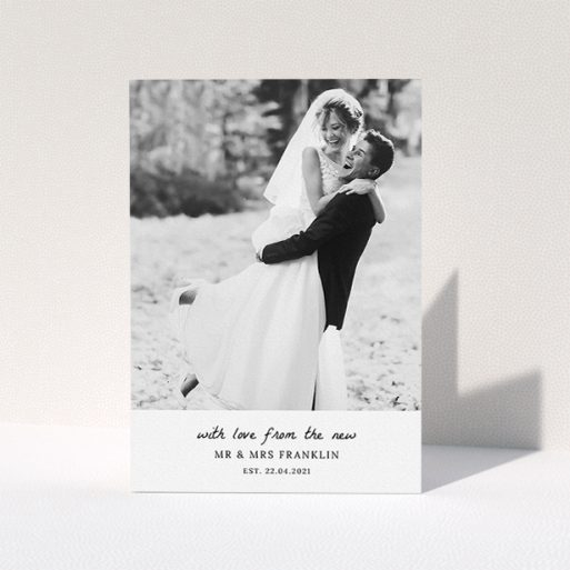 """A photo wedding thank you card design named """"Black and White Thanks"""". It is an A5 card in a portrait orientation. It is a photographic photo wedding thank you card with room for 1 photo. """"Black and White Thanks"""" is available as a folded card, with mainly white colouring."""