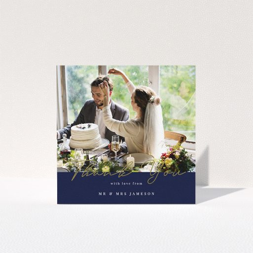 """A photo wedding thank you card called """"Blue and Gold"""". It is a square (148mm x 148mm) card in a square orientation. It is a photographic photo wedding thank you card with room for 1 photo. """"Blue and Gold"""" is available as a folded card, with tones of navy blue and white."""