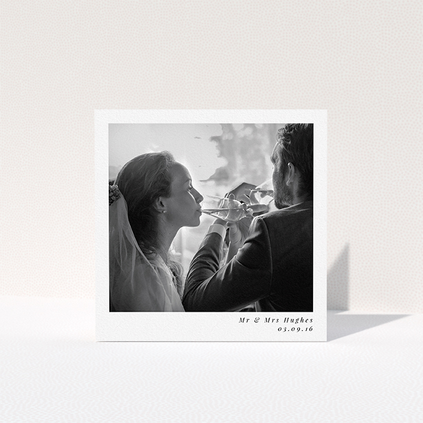 """A photo wedding thank you card design named """"Clean and simple"""". It is a square (148mm x 148mm) card in a square orientation. It is a photographic photo wedding thank you card with room for 1 photo. """"Clean and simple"""" is available as a folded card, with mainly white colouring."""