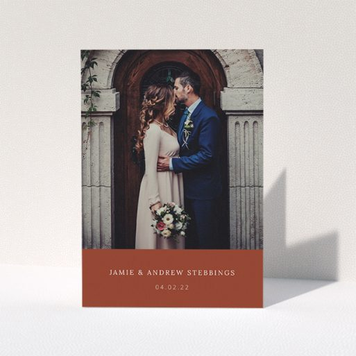 """A photo wedding thank you card design called """"Dark Ochre Footer"""". It is an A5 card in a portrait orientation. It is a photographic photo wedding thank you card with room for 1 photo. """"Dark Ochre Footer"""" is available as a folded card, with mainly dark orange colouring."""