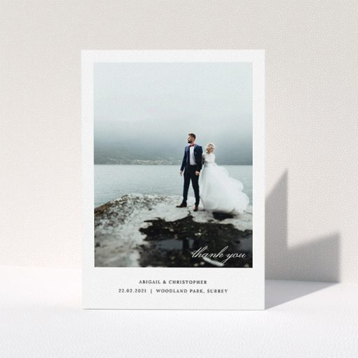 """A photo wedding thank you card template titled """"Elegant Photo Card"""". It is an A5 card in a portrait orientation. It is a photographic photo wedding thank you card with room for 1 photo. """"Elegant Photo Card"""" is available as a folded card, with mainly white colouring."""