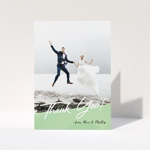 """A photo wedding thank you card design called """"Green Slant Thank You"""". It is an A6 card in a portrait orientation. It is a photographic photo wedding thank you card with room for 1 photo. """"Green Slant Thank You"""" is available as a folded card, with tones of green and white."""