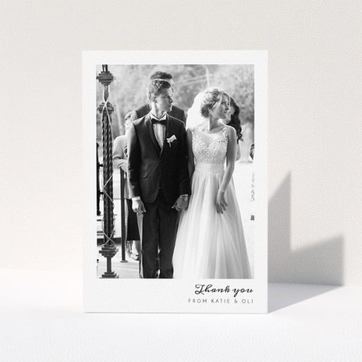 """A photo wedding thank you card design titled """"Handwritten script"""". It is an A5 card in a portrait orientation. It is a photographic photo wedding thank you card with room for 1 photo. """"Handwritten script"""" is available as a folded card, with mainly white colouring."""