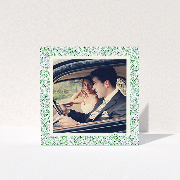 """A photo wedding thank you card called """"Hedge border"""". It is a square (148mm x 148mm) card in a square orientation. It is a photographic photo wedding thank you card with room for 1 photo. """"Hedge border"""" is available as a folded card, with tones of green and white."""