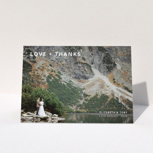 """A photo wedding thank you card design titled """"Love and Thanks Landscape"""". It is an A5 card in a landscape orientation. It is a photographic photo wedding thank you card with room for 1 photo. """"Love and Thanks Landscape"""" is available as a folded card, with mainly white colouring."""