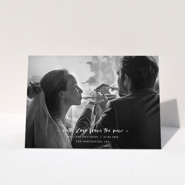 """A photo wedding thank you card design named """"Modern Wedding Photography"""". It is an A5 card in a landscape orientation. It is a photographic photo wedding thank you card with room for 1 photo. """"Modern Wedding Photography"""" is available as a folded card, with mainly white colouring."""