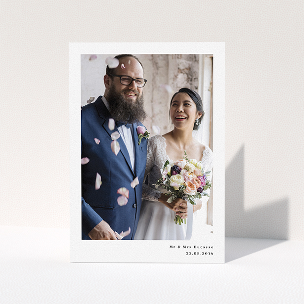 """A photo wedding thank you card called """"Most of the page"""". It is an A5 card in a portrait orientation. It is a photographic photo wedding thank you card with room for 1 photo. """"Most of the page"""" is available as a folded card, with mainly white colouring."""