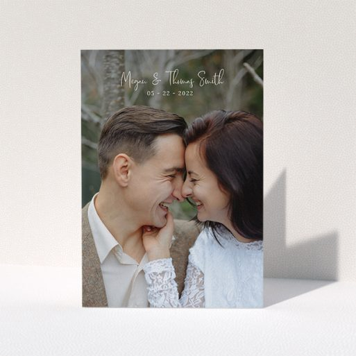 """A photo wedding thank you card template titled """"Name-Date-Photo"""". It is an A5 card in a portrait orientation. It is a photographic photo wedding thank you card with room for 1 photo. """"Name-Date-Photo"""" is available as a folded card, with mainly white colouring."""