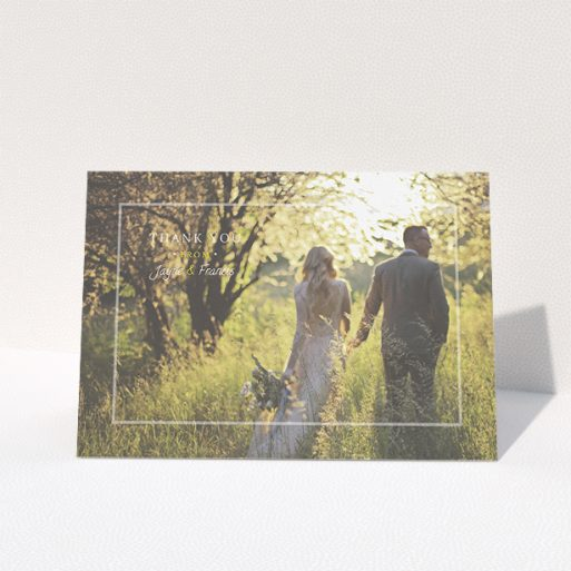 """A photo wedding thank you card called """"Not even there"""". It is an A5 card in a landscape orientation. It is a photographic photo wedding thank you card with room for 1 photo. """"Not even there"""" is available as a folded card, with mainly white colouring."""