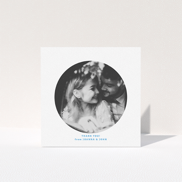 """A photo wedding thank you card design titled """"Photo hole"""". It is a square (148mm x 148mm) card in a square orientation. It is a photographic photo wedding thank you card with room for 1 photo. """"Photo hole"""" is available as a folded card, with tones of white and blue."""