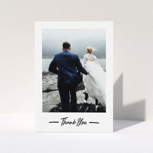 """A photo wedding thank you card called """"Portrait Thank You Photo"""". It is an A5 card in a portrait orientation. It is a photographic photo wedding thank you card with room for 1 photo. """"Portrait Thank You Photo"""" is available as a folded card, with mainly white colouring."""