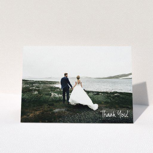 """A photo wedding thank you card named """"Rough but Simple Photo"""". It is an A5 card in a landscape orientation. It is a photographic photo wedding thank you card with room for 1 photo. """"Rough but Simple Photo"""" is available as a folded card, with mainly white colouring."""