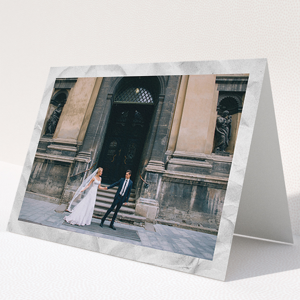 """A photo wedding thank you card named """"Sat on Marble"""". It is an A5 card in a landscape orientation. It is a photographic photo wedding thank you card with room for 1 photo. """"Sat on Marble"""" is available as a folded card, with mainly white colouring."""