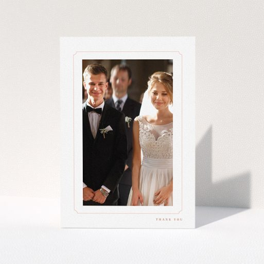 """A photo wedding thank you card design named """"Simple fine border"""". It is an A5 card in a portrait orientation. It is a photographic photo wedding thank you card with room for 1 photo. """"Simple fine border"""" is available as a folded card, with tones of white and pink."""
