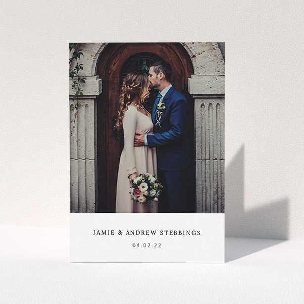 """A photo wedding thank you card design named """"Simple, Portrait Thank You"""". It is an A5 card in a portrait orientation. It is a photographic photo wedding thank you card with room for 1 photo. """"Simple, Portrait Thank You"""" is available as a folded card, with mainly white colouring."""