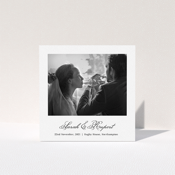 """A photo wedding thank you card design named """"Traditional Photo Thanks"""". It is a square (148mm x 148mm) card in a square orientation. It is a photographic photo wedding thank you card with room for 1 photo. """"Traditional Photo Thanks"""" is available as a folded card, with mainly white colouring."""