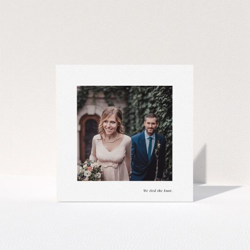 """A photo wedding thank you card design titled """"We tied the knot"""". It is a square (148mm x 148mm) card in a square orientation. It is a photographic photo wedding thank you card with room for 1 photo. """"We tied the knot"""" is available as a folded card, with mainly white colouring."""