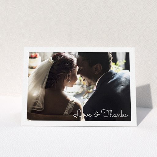 """A photo wedding thank you card design named """"Wedding Thanks Landscape"""". It is an A5 card in a landscape orientation. It is a photographic photo wedding thank you card with room for 1 photo. """"Wedding Thanks Landscape"""" is available as a folded card, with mainly white colouring."""