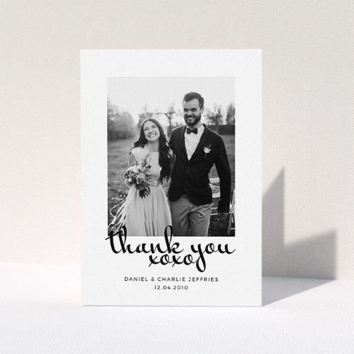 """A photo wedding thank you card design named """"XoXo"""". It is an A5 card in a portrait orientation. It is a photographic photo wedding thank you card with room for 1 photo. """"XoXo"""" is available as a folded card, with mainly white colouring."""