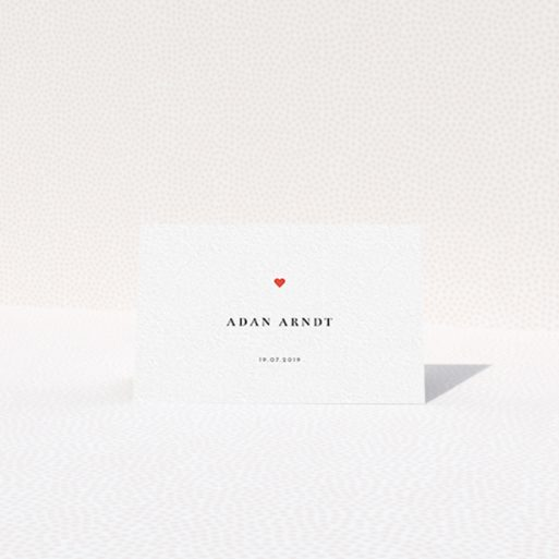 """A place setting card design titled """"A little heart"""". It is an 85 x 55mm card in a landscape orientation. """"A little heart"""" is available as a folded card, with tones of white and red."""