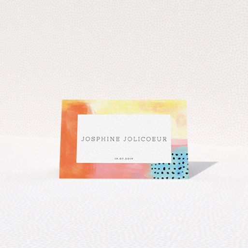 """A place setting card template titled """"Abstract Colours"""". It is an 85 x 55mm card in a landscape orientation. """"Abstract Colours"""" is available as a folded card, with tones of orange, red and yellow."""