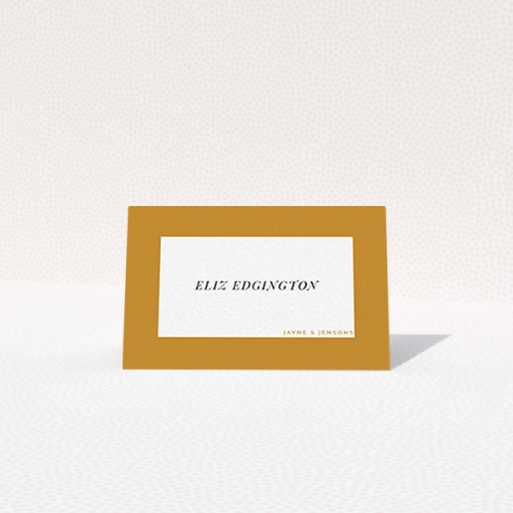 """A place setting card design called """"Big Copper"""". It is an 85 x 55mm card in a landscape orientation. """"Big Copper"""" is available as a folded card, with mainly dark orange colouring."""