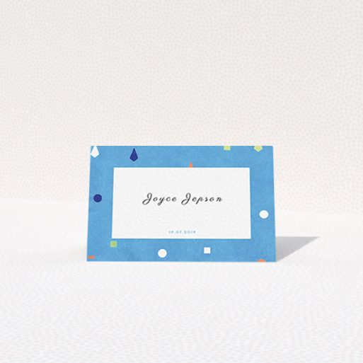 """A place setting card named """"Capri"""". It is an 85 x 55mm card in a landscape orientation. """"Capri"""" is available as a folded card, with tones of light blue and orange."""