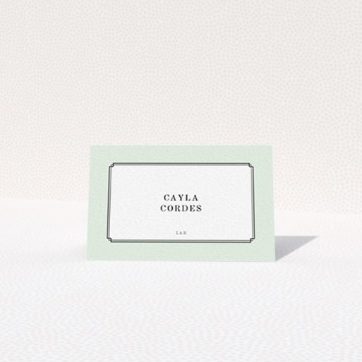 """A place setting card called """"Deco mint"""". It is an 85 x 55mm card in a landscape orientation. """"Deco mint"""" is available as a folded card, with tones of green and white."""
