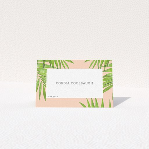 """A place setting card design called """"In the courtyard"""". It is an 85 x 55mm card in a landscape orientation. """"In the courtyard"""" is available as a folded card, with tones of green and pink."""