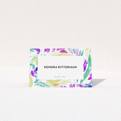 """A place setting card design titled """"Neon Florals"""". It is an 85 x 55mm card in a landscape orientation. """"Neon Florals"""" is available as a folded card, with tones of white, green and pink."""