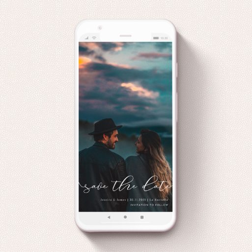 """A save the date for whatsapp design titled """"Across the Photo"""". It is a smartphone screen sized card in a portrait orientation. It is a photographic save the date for whatsapp with room for 1 photo. """"Across the Photo"""" is available as a flat card, with mainly white colouring."""