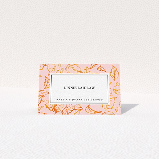 """A table place card design called """"Falling Foliage"""". It is an 85 x 55mm card in a landscape orientation. """"Falling Foliage"""" is available as a folded card, with tones of pink and orange."""