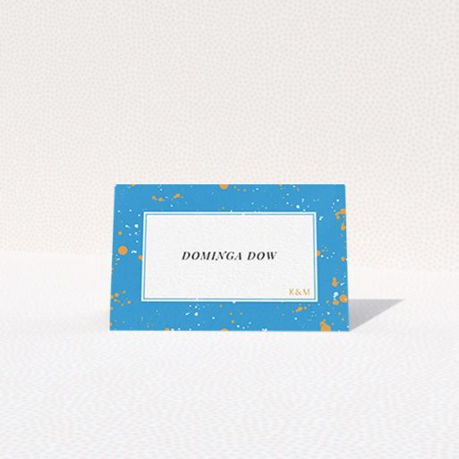 """A table place card named """"Orange Splatters"""". It is an 85 x 55mm card in a landscape orientation. """"Orange Splatters"""" is available as a folded card, with tones of light blue and orange."""