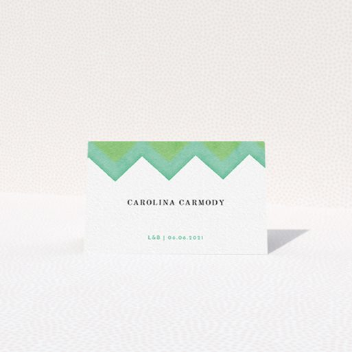 """A table place card named """"Vibrant Peaks"""". It is an 85 x 55mm card in a landscape orientation. """"Vibrant Peaks"""" is available as a folded card, with tones of green and white."""