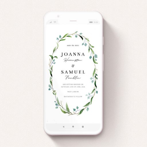 """A text message save the date design named """"Thin Watercolour Wreath"""". It is a smartphone screen sized save the date in a portrait orientation. """"Thin Watercolour Wreath"""" is available as a flat save the date, with tones of blue and green."""