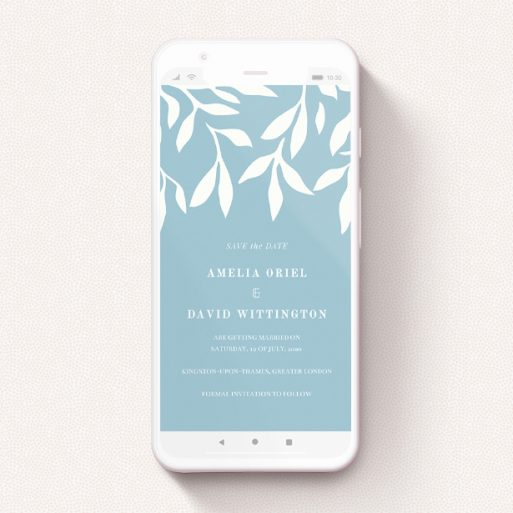 """A text message save the date design named """"Winter bloom """". It is a smartphone screen sized save the date in a portrait orientation. """"Winter bloom """" is available as a flat save the date, with tones of blue and white."""