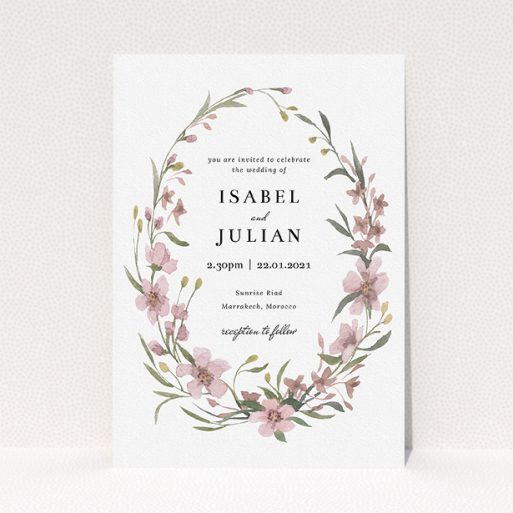 """A wedding invite card design named """"Autumn Floral Wreath"""". It is an A5 invite in a portrait orientation. """"Autumn Floral Wreath"""" is available as a flat invite, with tones of faded pink and autumnal green."""