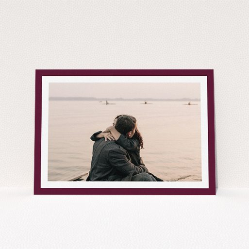 """A wedding invite card design titled """"Classic Burgundy Photo Frame"""". It is an A5 invite in a landscape orientation. It is a photographic wedding invite card with room for 1 photo. """"Classic Burgundy Photo Frame"""" is available as a flat invite, with tones of burgundy and white."""