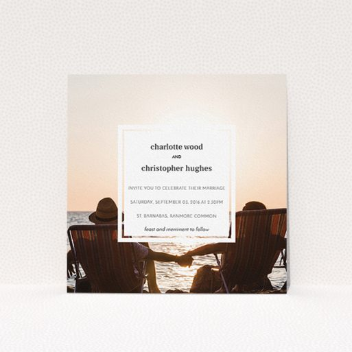 """A wedding invite card named """"In the suburbs"""". It is a square (148mm x 148mm) invite in a square orientation. It is a photographic wedding invite card with room for 1 photo. """"In the suburbs"""" is available as a flat invite, with mainly white colouring."""
