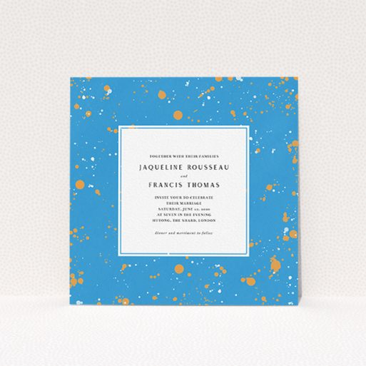 """A wedding invite card design titled """"Orange Splatters"""". It is a square (148mm x 148mm) invite in a square orientation. """"Orange Splatters"""" is available as a flat invite, with tones of light blue and orange."""
