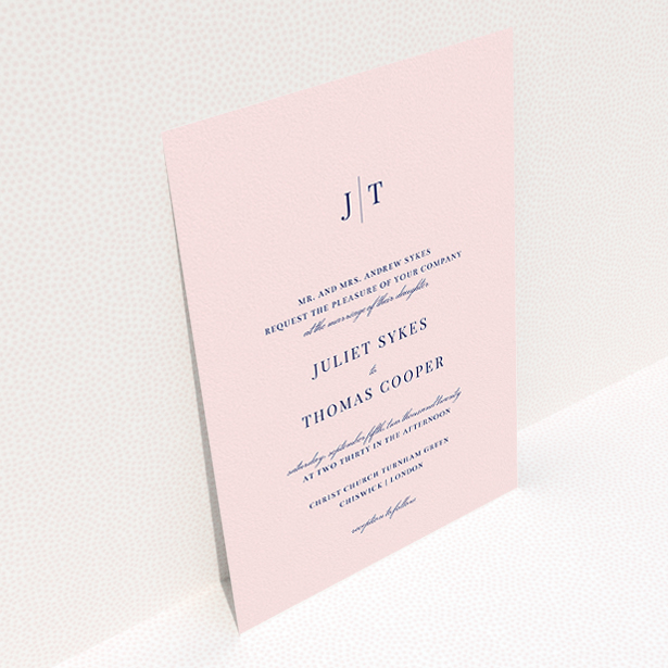 """A wedding invite card design titled """"Tradition in Pink"""". It is an A5 invite in a portrait orientation. """"Tradition in Pink"""" is available as a flat invite, with mainly pink colouring."""
