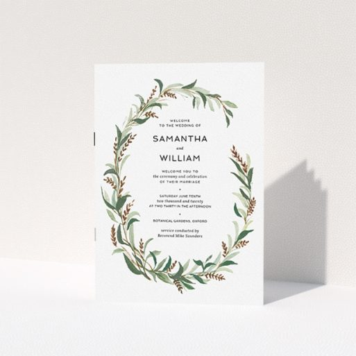 """A wedding order of service design named """"Winter Wreath"""". It is an A5 booklet in a portrait orientation. """"Winter Wreath"""" is available as a folded booklet booklet, with tones of faded green, light brown and light green."""