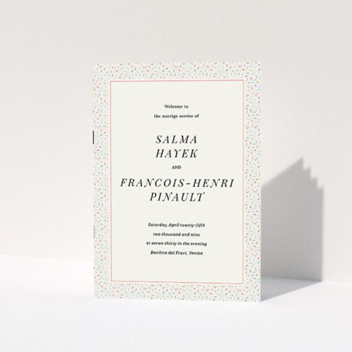 """A wedding program design named """"A hint of confetti"""". It is an A5 booklet in a portrait orientation. """"A hint of confetti"""" is available as a folded booklet booklet, with tones of light cream and green."""