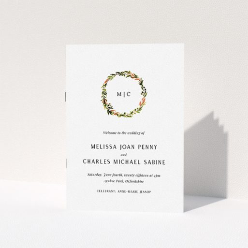 """A wedding program named """"Floral Monogram"""". It is an A5 booklet in a portrait orientation. """"Floral Monogram"""" is available as a folded booklet booklet, with tones of white and Orange."""