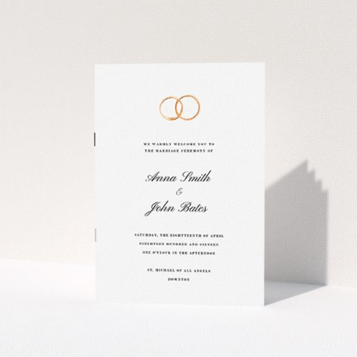 """A wedding program called """"The newlyweds"""". It is an A5 booklet in a portrait orientation. """"The newlyweds"""" is available as a folded booklet booklet, with tones of white and gold."""
