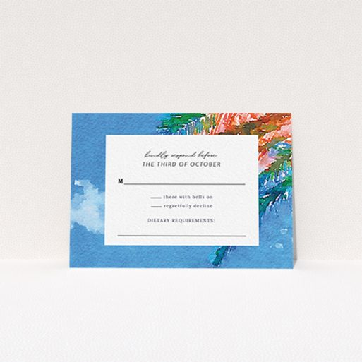 """A wedding response card design called """"From the Sunbed"""". It is an A7 card in a landscape orientation. """"From the Sunbed"""" is available as a flat card, with tones of sky blue and green."""