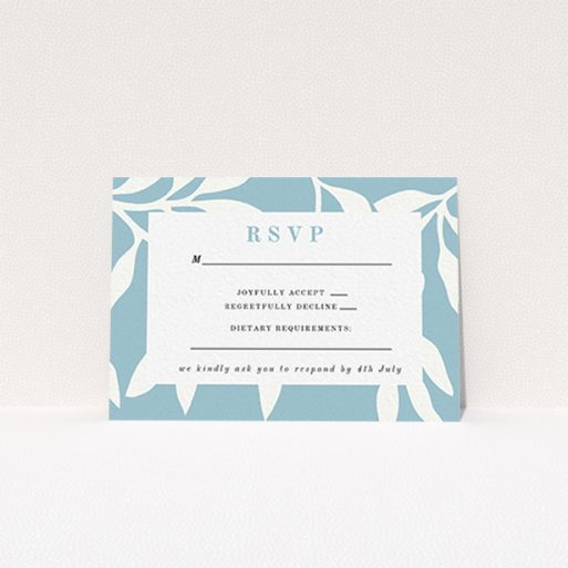 """A wedding response card template titled """"Winter bloom"""". It is an A7 card in a landscape orientation. """"Winter bloom"""" is available as a flat card, with tones of blue and white."""
