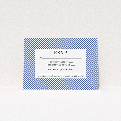 """A wedding rsvp card template titled """"Between the Lines"""". It is an A7 card in a landscape orientation. """"Between the Lines"""" is available as a flat card, with tones of blue and white."""